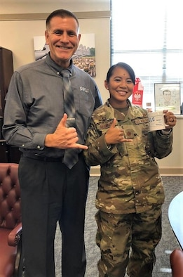 "Photo caption: Major Charlynne ""Char"" McGinnis stops by AFCLC Director's Howard Ward's office"