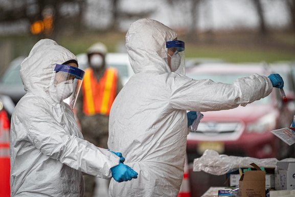 New Jersey Air National Guard medics with the 108th Wing process specimens at a COVID-19 Community-Based Testing Site at the PNC Bank Arts Center in Holmdel, N.J., March 23, 2020.  The testing site, established in partnership with the Federal Emergency Management Agency, is staffed by the New Jersey Department of Health, the New Jersey State Police, and the New Jersey National Guard. (U.S. Air National Guard photo by Master Sgt. Matt Hecht)