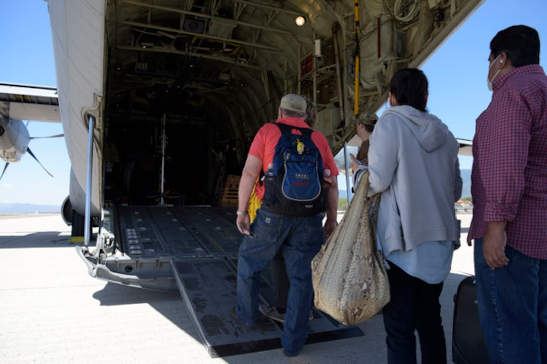 U.S. citizens board a U.S. Air Force C-130J Super Hercules at Soto Cano Air Base, Honduras, March 25, 2020. The aircraft was used to transport 78 evacuees from Honduras to Naval Air Station Norfolk, Va. The mission is part of an ongoing interagency effort led by the U.S. State Department to assist American citizens unable to return home from countries around the world during the COVID-19 pandemic. (U.S. Air Force photo by Tech. Sgt. Daniel Owen)