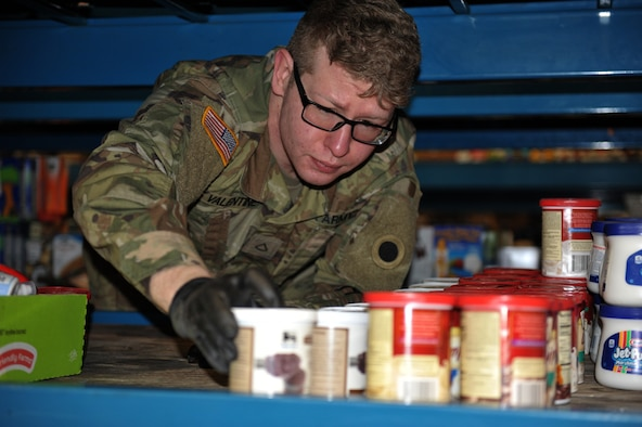 Spc. Patrick Valentine, assigned to the Ohio National Guard's HHC 1-148th Infantry Regiment – 37th Infantry Brigade Combat Team, stocks shelves at the Toledo Northwestern Ohio Food Bank, March 25, 2020. Nearly 400 Ohio National Guard members were activated to provide humanitarian missions in support of COVID-19 relief efforts.
