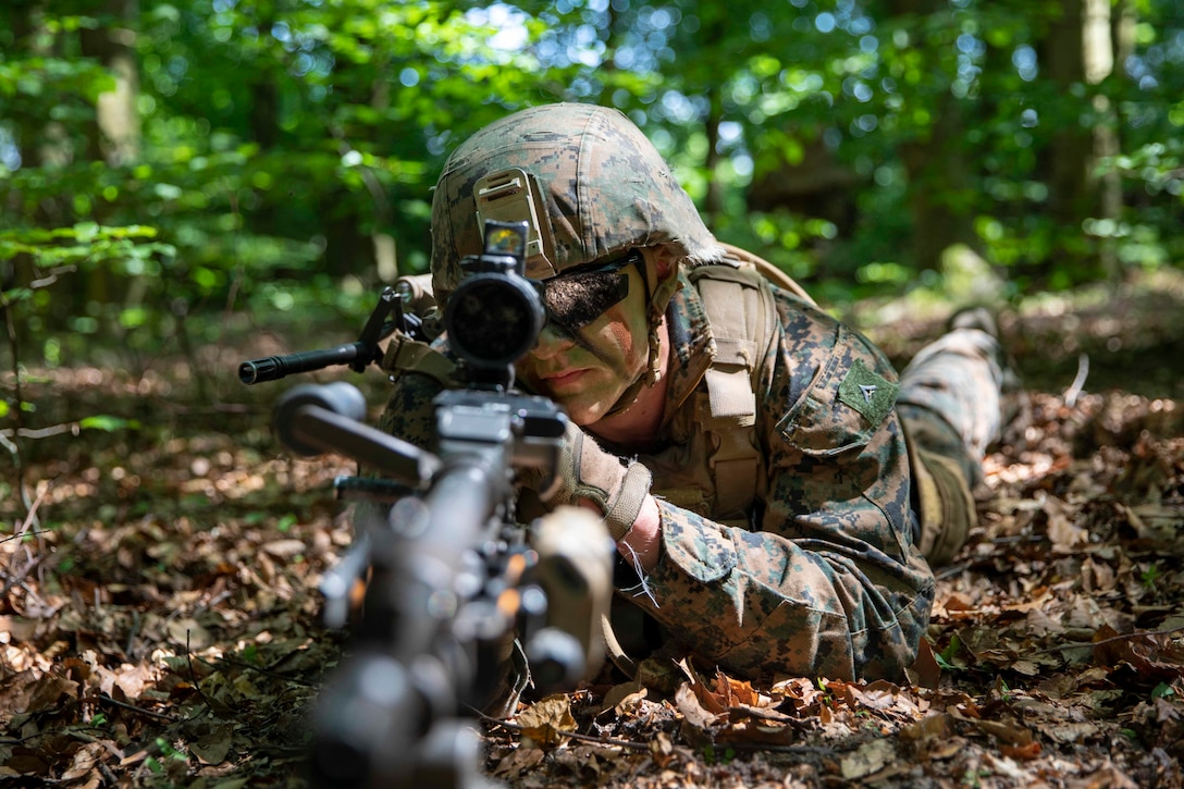 A U.S. Marine holds security with a M240B machine gun during a tactics exercise for Baltic Operations 2019.