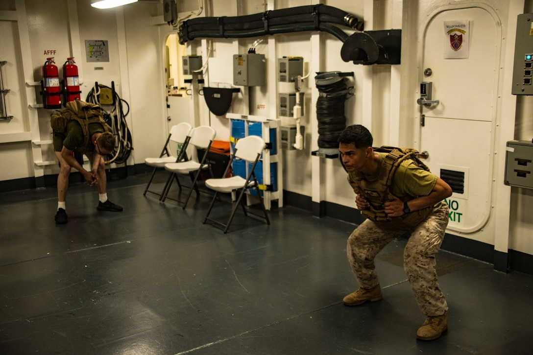 U.S. Marines participate in a 'Murph' workout challenge in memory of Gunnery Sgt. Diego Pongo and Capt. Moises Navas aboard amphibious assault ship USS America (LHA 6). .