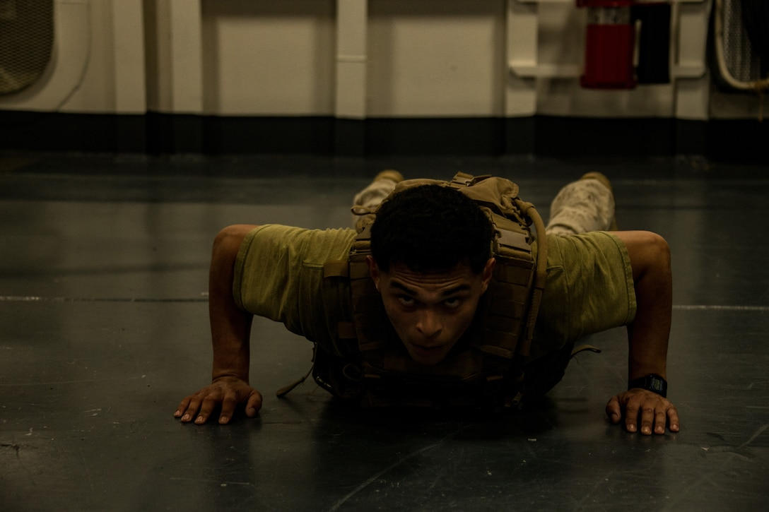 A U.S. Marine participates in a 'Murph' workout challenge in memory of Gunnery Sgt. Diego Pongo and Capt. Moises Navas aboard amphibious assault ship USS America (LHA 6).