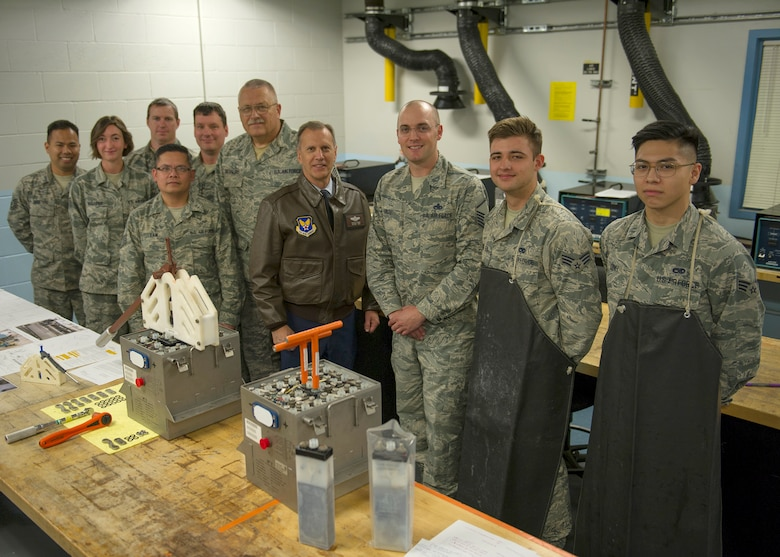 Reserve Citizen Airmen from the 446th Maintenance Squadron pose with Maj. Gen. Randall Ogden, 4th Air Force commander, along with the current C-17 Globemaster III battery extraction device and the 446th MXS's new extraction device, at Joint Base Lewis-McChord, Washington. (Senior Airman Christopher Sommers)