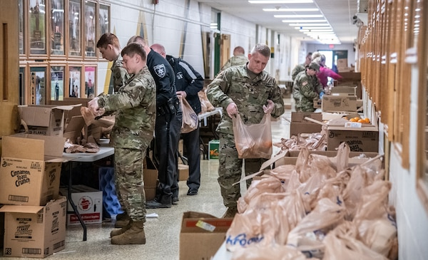 Members of the West Virginia National Guard assist volunteers with the Greater Greenbrier Long Term Recovery Committee in preparing meals for more than 3,600 school-age students throughout Greenbrier County, West Virginia, during the COVID-19 pandemic outbreak, March 25, 2020, in Lewisburg, West Virginia. The Soldiers supported more than 30 volunteers in packaging and delivering the meals to needy children around the county and will continue to do so for the duration of the outbreak. (U.S. Army National Guard photo by Edwin L. Wriston)