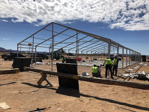 LOGCAP contractors erect a structure that will be used to quarantine for 14 days Soldiers returning from overseas deployments