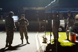 Photo of Airmen preparing for health screening operations.