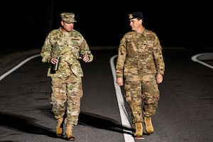 Photo of Airmen talking and walking.
