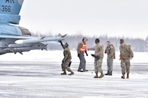 Airmen assigned to the 354th Aircraft Maintenance Squadron conduct pre-flight checks on an F-16 Fighting Falcon from the 18th Aggressor Squadron at Eielson Air Force Base, Alaska, March 24, 2020. Air Force maintainers inspect every part of the aircraft to ensure the pilot is safe and able to carry out the mission. (U.S. Air Force photo by Senior Airman Beaux Hebert)