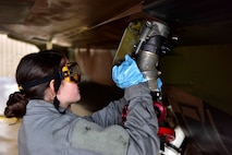 Airman 1st Class Angelia Fisher, a 354th Aircraft Maintenance Squadron crew chief, refuels an F-16 Fighting Falcon on Eielson Air Force Base, Alaska, March 24, 2020. Airmen from the 354th AMXS are following the Department of Defense policies for preventing the spread of COVID-19 while ensuring that the aircraft at Eielson are safe and ready to complete their mission. Policies include enforcing social distancing, good hygiene and personal care and sanitizing their work areas often. (U.S. Air Force photos by Senior Airman Beaux Hebert)