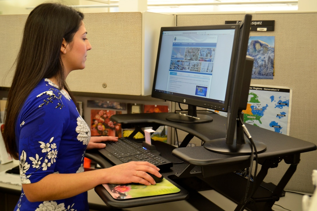 Erica Vasquez, a Medical tailored vendor logistics specialist, uses her new sit-to-stand desk at DLA Troop Support March 10, 2020 in Philadelphia.