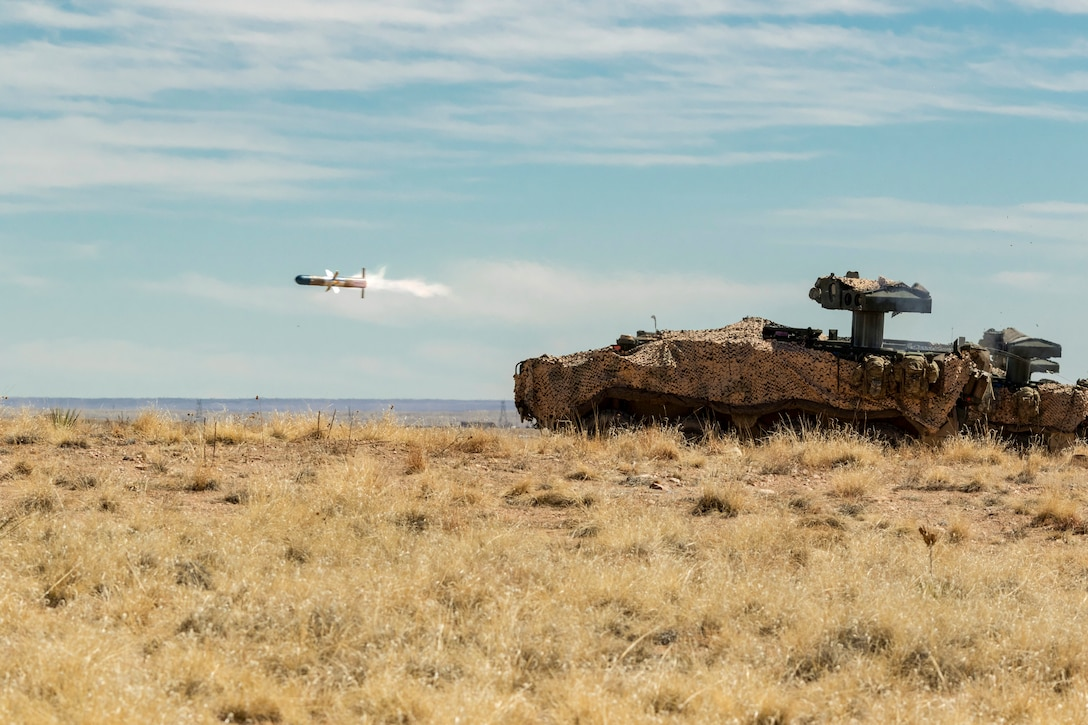 A missile shoots forward from a military vehicle
