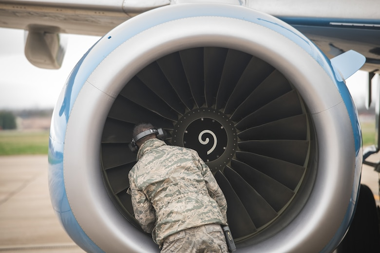 Tech. Sgt. Brandon Zangeneh, crew chief, 932nd Maintenance Squadron, performs a physical preflight inspection March, 20, 2020 Scott Air Force Base Illinois as the 932nd Airlift Wing and 73rd Airlift Squadron continue training operations during COVID-19.  Pilots are required to maintain readiness and the 932nd MXS is working hard with reduced manning in support of continued missions. The 932nd Airlift Wing is the only Air Force Reserve Command unit that flies the C-40C, which is used to provide world-class airlift for U.S. national and military leaders.(U.S. Air Force photo by Christopher Parr)