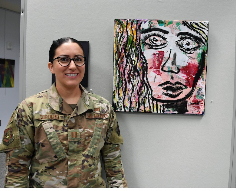 Capt. Lindsay Cordero and her painting on exhibit.