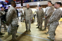 Commandant of the Marine Corps Gen. David H. Berger speaks with Marines after a town hall while visiting Al Taqaddum, Iraq, Dec. 11, 2019. Gen. Berger spoke about his expectations for the force and thanked Marines for their continued success. He also met with Marine Corps leaders to discuss current and future partnerships across the region. This is Gen. Berger's first visit to the CENTCOM area of operation as Commandant.