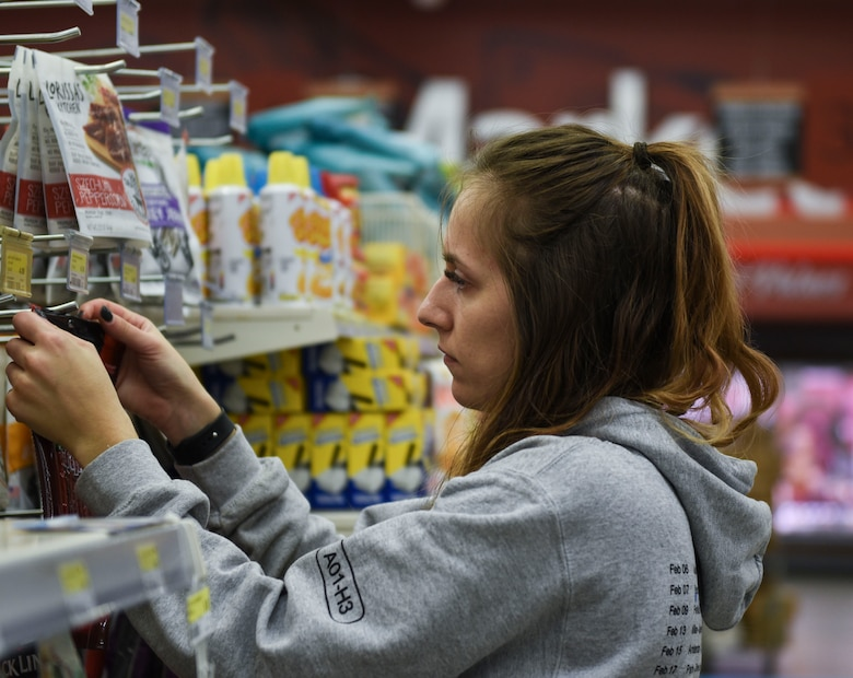 Brittany Ford, United Service Organizations center operation specialist, stocks grocery items in the Commissary at Spangdahlem Air Base, Germany, March 23, 2020. Ford said she wanted to help out as much as she could while she has to work from home. (U.S. Air Force photo by Senior Airman Melody W. Howley)