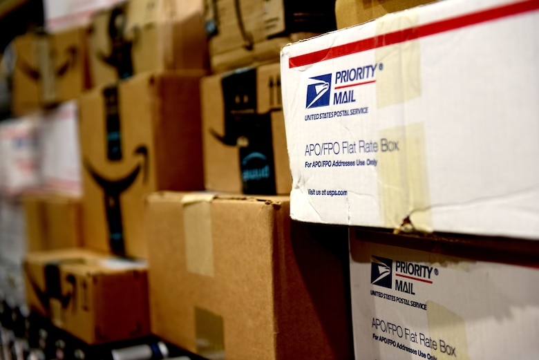 Boxes of mail await sorting at the Aviano Post Office, Aviano Air Base, Italy, March 25, 2020. Hundreds of packages travel through the post office every day, delivering essential items to members of Team Aviano. (U.S. Air Force photo by Staff Sgt. Kelsey Tucker)