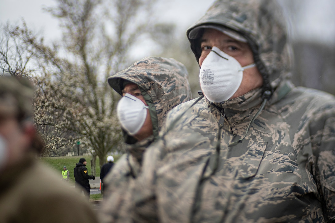 New Jersey Air National Guard medics with the 108th Wing observe procedures at a COVID-19 Community-Based Testing Site at the PNC Bank Arts Center in Holmdel, N.J., March 23, 2020.  The testing site, established in partnership with the Federal Emergency Management Agency, is staffed by the New Jersey Department of Health, the New Jersey State Police, and the New Jersey National Guard.
