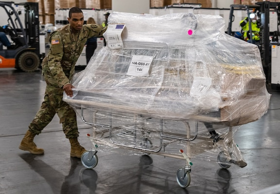 The New York National Guard, working with the Federal Emergency Management Agency and local, state and federal partners bring in hospital supplies to the Jacob Javits Center in New York March 23, 2020, to handle expected patient overflow. The facility will start with 250 beds with the capability to expand to 1,000 beds.