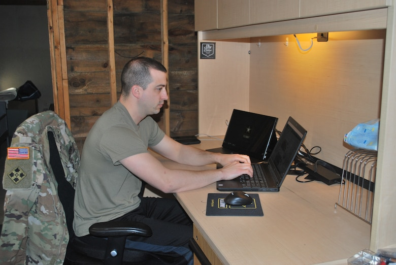 A makeshift office in his basement allows Staff Sgt. Andrew Menard, to continue recruiting for the force.