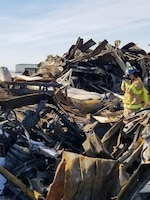 On Dec. 28, 2019, a fire gutted a Strategic Air Command-era hangar on Miniot Air Force Base, N.D. Office of Special Investigations Detachment 813 and 2nd Field Investigations Squadron teamed with the Bureau of Alcohol, Tobacco, Firearms and Explosives to conduct the subsequent investigation. Here, Special Agent Andrew Weinzierl photographs scene conditions to help determine the origin and cause of the blaze resulting in a $7M loss to the Air Force. (Photo by Investigator Jesse Gomez, OSI Det. 813)