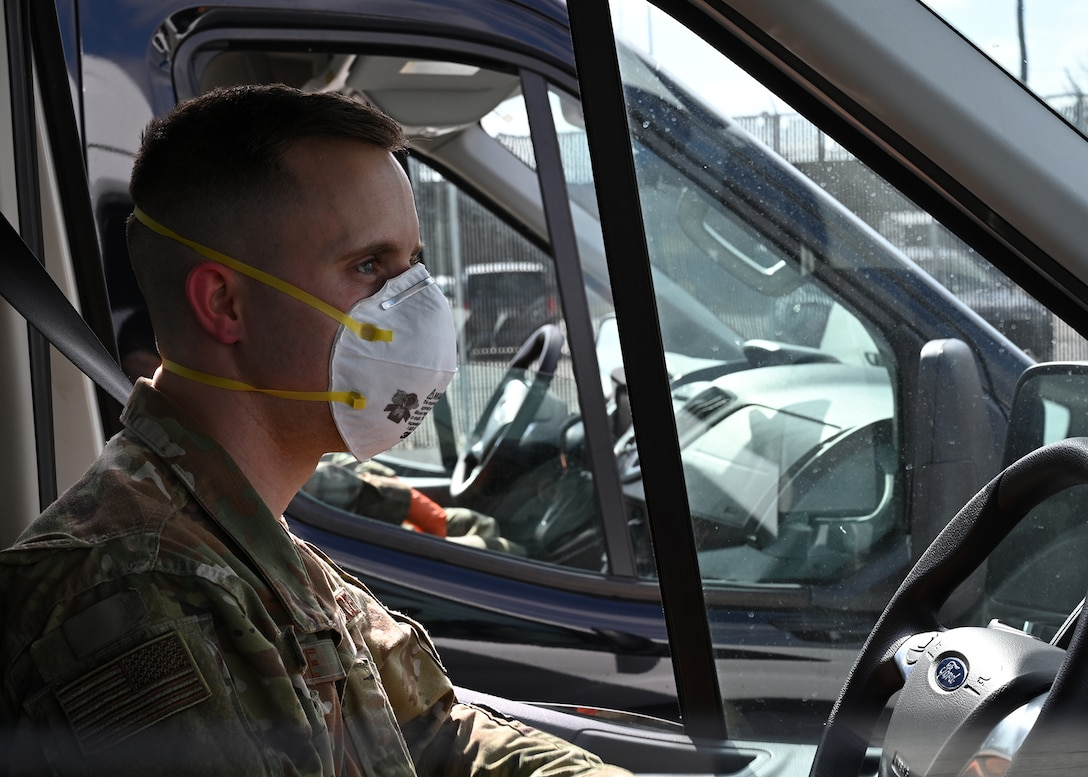 U.S. Air Force Airman First Class Brian Leschke, 175th Maintenance Squadron, Maryland Air National Guard, wears medical personal protective equipment at Baltimore Washington International Airport, March 17, 2020, before transporting passengers from the Grand Princess cruise ship who have been quarantined due to the novel Coronavirus (COVID-19) pandemic. The Maryland National Guard has activated 1,000 personnel with another 1,200 Airmen and Soldiers ready at an enhanced state of readiness. (U.S. Air National Guard photo by Master. Sgt. Chris Schepers)
