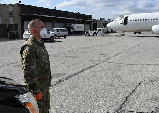 U.S. Air Force Master Sgt. William Hohman, 275th Cyberspace Operations Squadron, Maryland Air National Guard, stands ready at Baltimore Washington International Airport, March 17, 2020, before transporting passengers from the Grand Princess cruise ship who have been quarantined due to the novel Coronavirus (COVID-19) pandemic. The Maryland National Guard has activated 1,000 personnel with another 1,200 Airmen and Soldiers ready at an enhanced state of readiness. (U.S. Air National Guard photo by Master. Sgt. Chris Schepers)