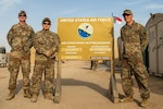 U.S. Airmen from the North Carolina Air National Guard's 156th Weather Flight, 145th Air Wing, in front of the 22nd Expeditionary Weather Squadron sign while deployed in the U.S. Army Central Command area of responsibility, March 19, 2020. The Airmen predicted a severe sandstorm in late February supporting the 30th Armored Brigade Combat Team.