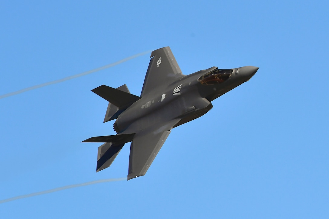 An F-35A Lightning II flies over Hill Air Force Base, Utah, March 12, 2020. Airmen continue to fly and train to maintain readiness during the current coronavirus crisis, with new procedures designed to maintain social distancing and disinfect equipment between uses. (U.S. Air Force photos by Todd Cromar)