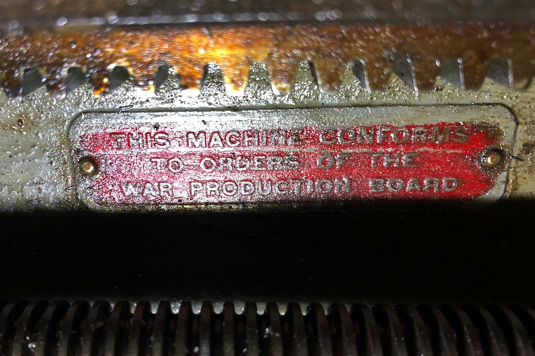 An identification plate identifies a machine.