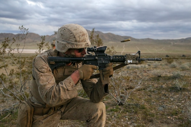 U.S. Marine Corps Lance Cpl. Samuel Argentieri, a light armored vehicle mechanic, with 2nd Light Armored Reconnaissance Battalion, 2nd Marine Division, fires his rifle at a notional enemy target during a live-fire range on the National Training Center 20-05 in Ft. Irwin, Calif., March 22, 2020. The National Training Center is a unique opportunity that allows Marines and Sailors to train with and against a peer competitor in a conventional combat operational setting. (U.S. Marine Corps photo by Cpl. Elijah J. Abernathy)