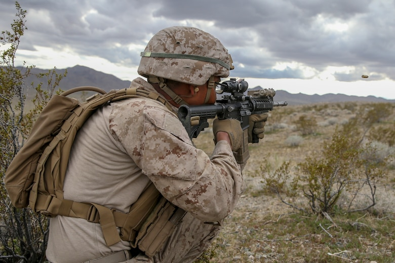 U.S. Marine Corps Pfc. Andy Solis, a rifleman with 2nd Light Armored Reconnaissance Battalion, 2nd Marine Division, fires his rifle at a notional enemy target during a live-fire range on the National Training Center 20-05 in Ft. Irwin, Calif., March 22, 2020. The National Training Center is a unique opportunity that allows Marines and Sailors to train with and against a peer competitor in a conventional combat operational setting. (U.S. Marine Corps photo by Cpl. Elijah J. Abernathy)