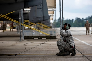 Photo of Airman performing preflight checks.
