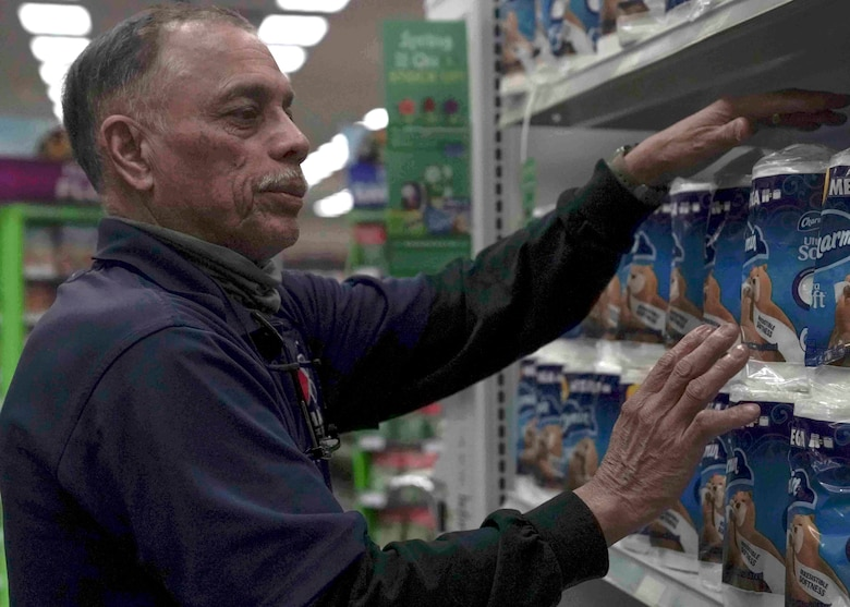 Rich Vega, stockroom manager, restocks toilet paper in the Exchange on Nellis Air Force Base, Nevada, March 25, 2020. The Exchange and commissary have prioritized restocking high-demand items, such as toilet paper and hand sanitizer, which sell out quickly during the COVID-19 pandemic. (U.S. Air Force photo by Senior Airman Stephanie Gelardo)