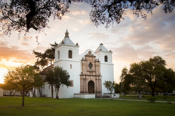 JBSA-Randolph's main chapel is photographed during the morning with the sun rising behind it.