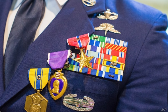 Decorations hang on the blue uniform lapel of an Airman