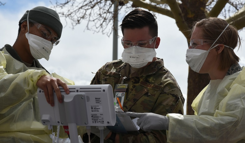Members of the 377th Medical Group prepare to test a patient for COVID-19