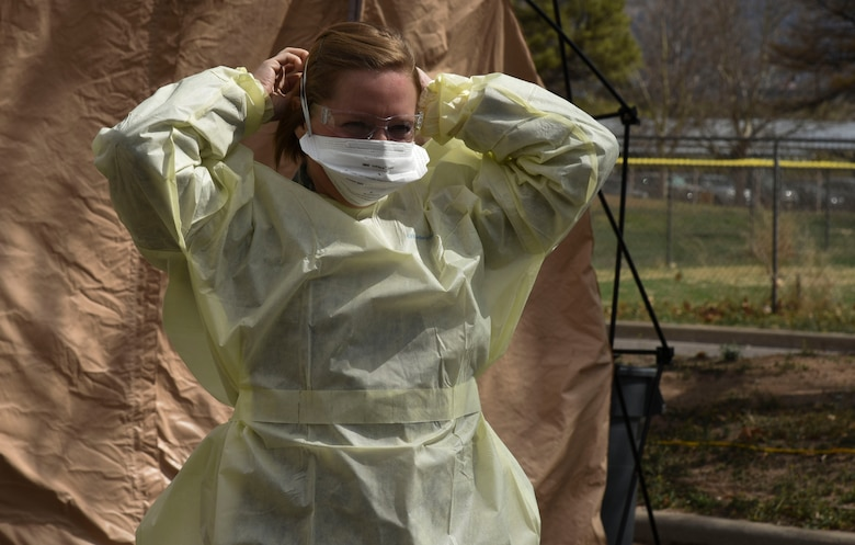 medical personnel put on personal protective equipment (PPE)