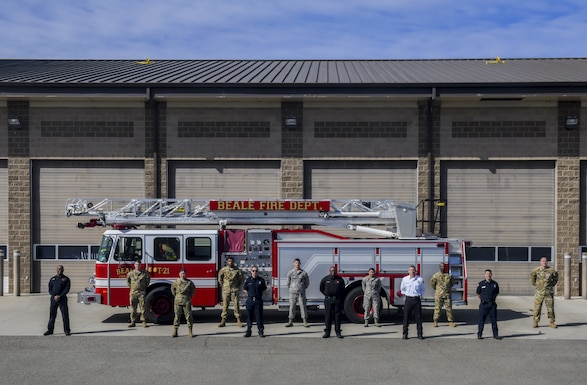 A fire engine is parked in the department loading bay at Beale Air Force Base