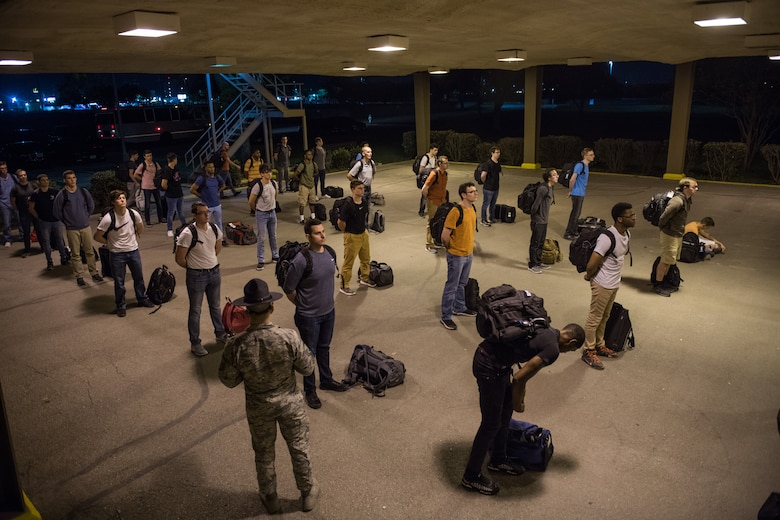U.S. Air Force basic training trainees that will be placed in a 14-day restriction of movement period arrive at the 737th Training Support Squadron March 24, 2020, at Joint Base San Antonio-Lackland, Texas.