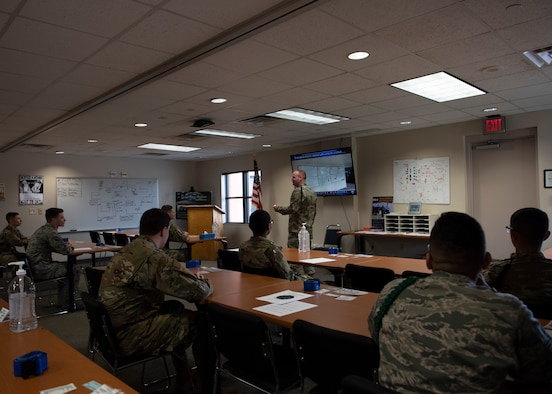 Tech. Sgt. Daryl Ackerman, 363rd Training Squadron military training leader, gives a brief to Airmen in Training at Sheppard Air Force Base, Texas, March 27, 2020. For military training leaders, teleworking isn't a possibility. The MTL's are working shorter hours to minimize exposure but still get the same amount of work done they do on normal hours. (U.S. Air Force photo by Senior Airman Pedro Tenorio)