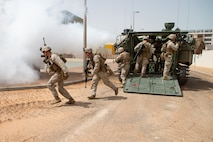 U.S. Marines with Charlie Company, 1st Battalion, 1st Marine Regiment, dismount an AAV-P7/A1 assault amphibious vehicle while participating in an urban operations assault demonstration during exercise Native Fury 20 in the United Arab Emirates, March 23, 2020. Native Fury 20 is a joint, bilateral exercise with the United Arab Emirates Armed Forces demonstrating the ability to respond to contingencies, natural disasters and other crises in the region. (U.S. Marine Corps photo by Lance Cpl. Brendan Mullin)
