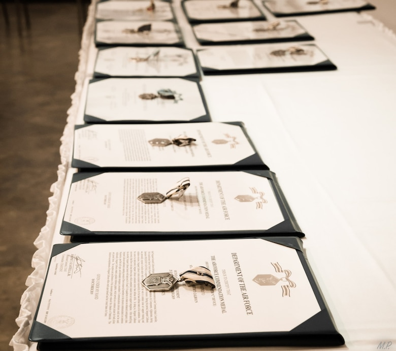 Awards lay on a table at the Museum of the Mighty Eighth Air Force in Savannah, Georgia, for a valorous awards ceremony honoring the achievements of Special Tactics Airmen from the 17th Special Tactics Squadron's Detachment 1 Feb. 18, 2020.