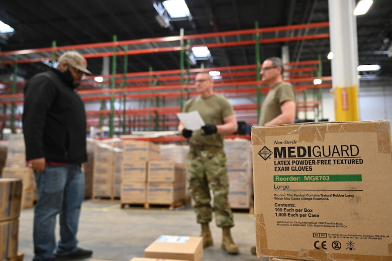 Members of the Maryland Air National Guard 175th Logistics Readiness Squadron work with members of the Maryland Office of Preparedness and Response March 19, 2020, to prepare and load medical supplies and equipment at the Maryland Strategic National Stockpile location. All assets provided were prioritized for health care workers and hospitals in response to the COVID-19 pandemic. (U.S. Air National Guard photo by Master Sgt. Christopher Schepers)