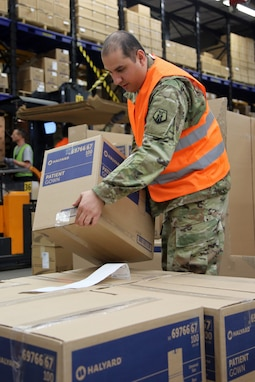 U.S. Army Reserve Sgt. Farid Tehrani, a supply sergeant with Medical Support Unit-Europe, 7th Mission Support Command, loads boxes of medical supplies onto a pallet at the U.S. Army Medical Materiel Center, Europe warehouse in Pirmasens, Germany, March 26, 2020. 7th MSC Soldiers are supporting the shipping and receiving functions in the warehouse to help with the high demand of Army Class VIII medical supplies during the COVID-19 pandemic.