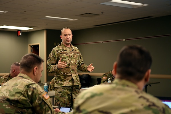 U.S. Air Force 1st Lt. Justin Rainier, a logistics readiness officer, assigned to the 178th Wing was called to State Active Duty and is currently serving on Joint Task Force-37 for Operation Steady Resolve, briefs commanders March 23, 2020, at the Defense Supply Center in Columbus, Ohio.