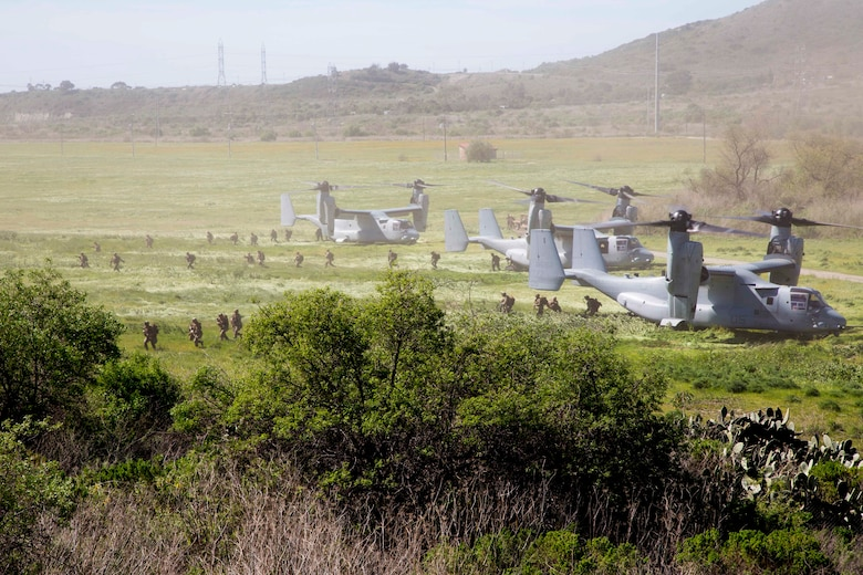 Three MV-22B Ospreys assigned to Marine Tiltrotor Squadron (VMM) 362, Marine Aircraft Group (MAG) 16, 3rd Marine Aircraft Wing (MAW), insert Marines at a simulated weapons engagement zone during an air assault in support of 1st Battalion, 3rd Marine Regiment, at Camp Pendleton, Calif., Feb. 26, 2020. Air assaults enable commanders to avoid enemy surfaces, exploit gaps, and maintain the flexibility and mobility needed to strike objectives in otherwise inaccessible areas during a Marine Air Ground Task Force mission. This culminating event signified that VMM-362 has reached full operational capability since its reactivation in 2018, ultimately increasing the lethality of 3rd MAW. (U.S Marine Corps photo by Lance Cpl. Julian Elliott-Drouin)