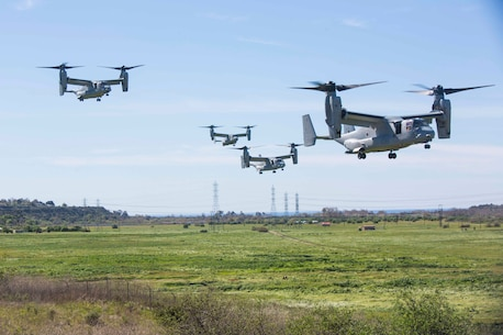 Four MV-22B Ospreys assigned to Marine Tiltrotor Squadron (VMM) 362, Marine Aircraft Group (MAG) 16, 3rd Marine Aircraft Wing (MAW), land near a simulated weapons engagement zone during an air assault in support of 1st Battalion, 3rd Marine Regiment, at Camp Pendleton, Calif., Feb. 26, 2020. Air assaults enable commanders to avoid enemy surfaces, exploit gaps, and maintain the flexibility and mobility needed to strike objectives in otherwise inaccessible areas during a Marine Air Ground Task Force mission. This culminating event signified that VMM-362 has reached full operational capability since its reactivation in 2018, ultimately increasing the lethality of 3rd MAW. (U.S Marine Corps photo by Lance Cpl. Julian Elliott-Drouin)