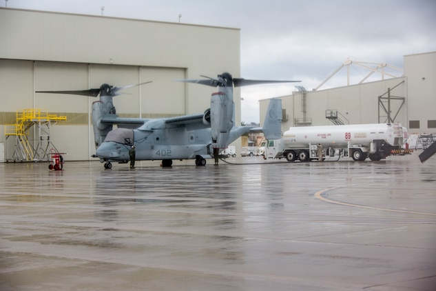 U.S. Marines with Marine Medium Tiltrotor Squadron 362, Marine Aircraft Group 16, 3rd Marine Aircraft Wing, enforce precautionary measures during the maintenance of MV-22 Osprey on Marine Corps Air Station Miramar, Calif., March 19, 2020. The purpose of these measures is to mitigate the spread of COVID-19 while continuing to perform mission essential tasks.(U.S. Marine Corps photo by Lance Cpl. Julian Elliott-Drouin)
