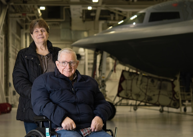 Ken Robbins and his wife, Jean, pose for a photo with the B-2 Spirit Stealth Bomber at Whiteman Air Force Base, Missouri, February 7, 2020. Robbins was invited to Whiteman AFB to fulfill his dream of seeing the B-2 in person. (U.S. Air Force photo by Senior Airmen Thomas Barley)